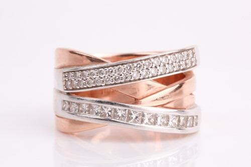 Lot 43 - A two colour, four row, diamond set cross-over...