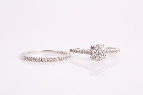 Lot 36 - A silver and diamond cluster engagement style...