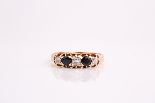 Lot 39 - An 18ct yellow gold, diamond, and sapphire...