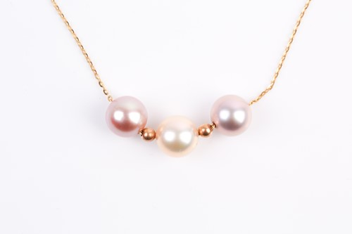 Lot 5 - A three stone mixed colour cultured pearl...