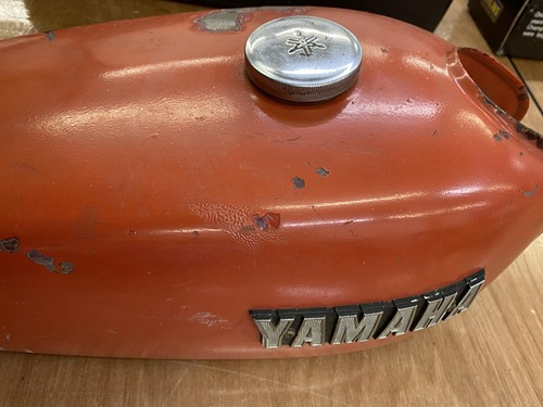 Lot 35 - Two Yamaha red fuel tanks.