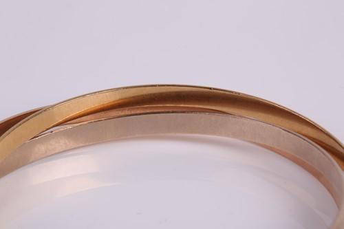 Lot 339 - Cartier. A vintage 'Trinity' bangle, designed...