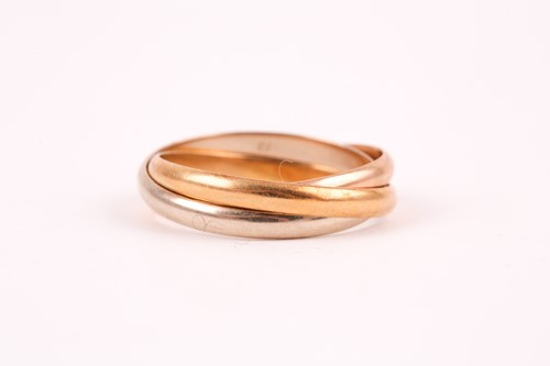 Lot 51 - A Cartier 'Trinity' three colour gold ring; in...