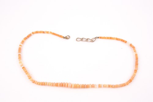 Lot 10 - A opal bead necklace, the graduated roundels...