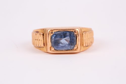 Lot 27 - A yellow metal and sapphire ring, set east to...