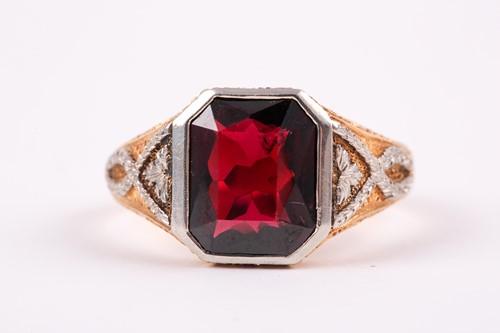 Lot 59 - A gentleman's yellow gold and garnet ring, set...