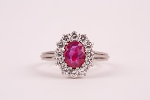 Lot 9 - A ruby and diamond cluster ring, the oval...