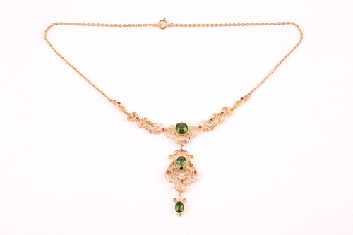 Lot 7 - An Art Nouveau 15ct yellow gold and tourmaline...