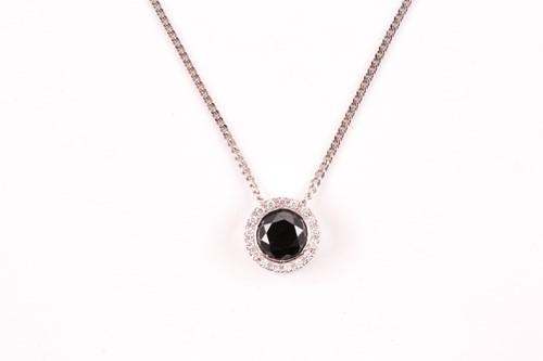 Lot 57 - An 18ct white gold and black diamond pendant,...