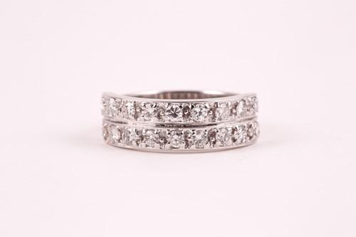 Lot 60 - A double band half eternity diamond ring, set...