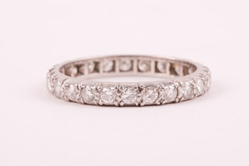 Lot 14 - A diamond eternity ring; the mixed round...