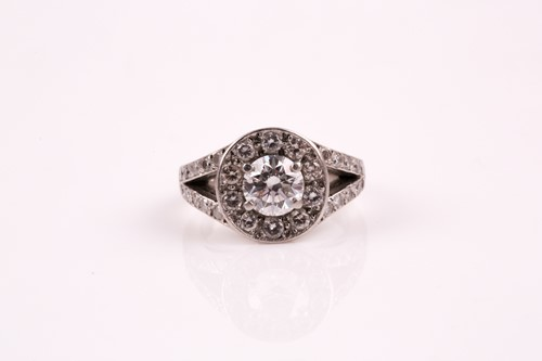 Lot 19 - A diamond cluster ring, the central brilliant...