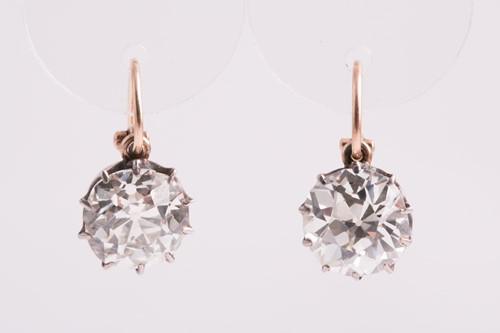 Lot 373 - A pair of Old European cut solitaire diamond...