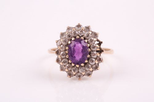Lot 22 - A 9ct yellow gold, amethyst, and white paste...