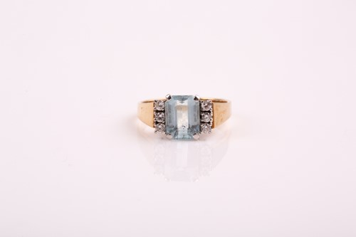 Lot 24 - An aquamarine and diamond ring; the step cut...
