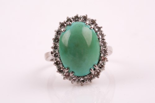 Lot 32 - A diamond and turquoise cluster ring, set with...