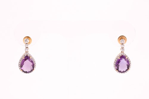 Lot 26 - A pair of diamond and amethyst drop earrings,...