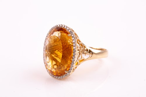 Lot 36 - A 14ct yellow gold, diamond, and citrine...