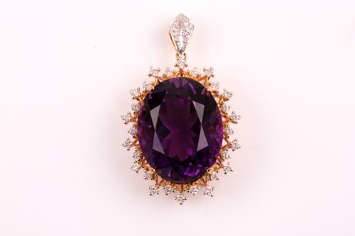 Lot 39 - An 18ct yellow gold, diamond, and amethyst...