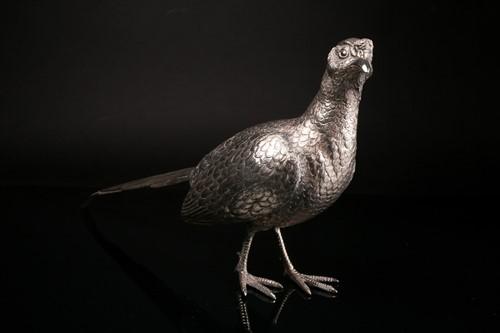 Lot 448 - A modern cast silver cock & hen pheasant,...