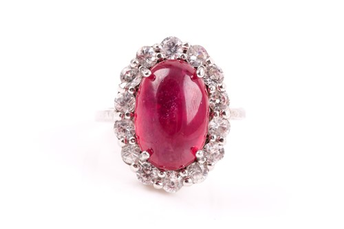 Lot 29 - A silver, cubic zirconia, and glass-filled...