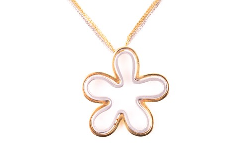 Lot 30 - An 18ct white and yellow gold floral splash...