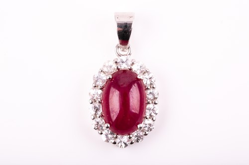 Lot 36 - A silver, ruby, and white sapphire pendant of...