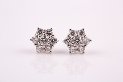 Lot 18 - A pair of 18ct white gold and diamond stud...
