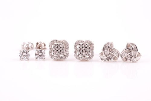 Lot 4 - A pair of 9ct white gold and solitaire CZ stud...