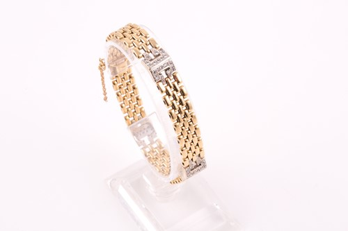 Lot 2 - An 18ct yellow gold and diamond bracelet, the...