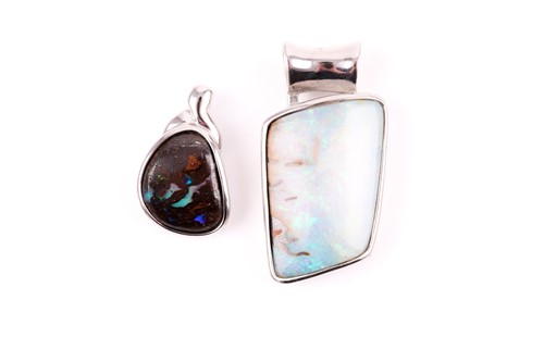 Lot 34 - A silver and opal pendant, mounted with a...