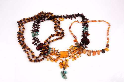 Lot 46 - An opera-length multi-coloured amber necklace,...