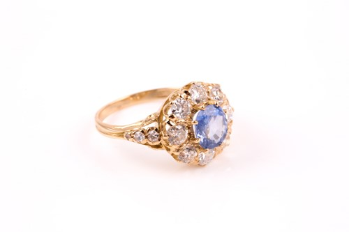 Lot 270 - An 18ct yellow gold, diamond, and sapphire...