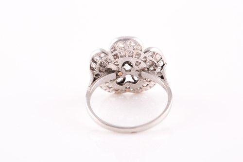 Lot 1 - A platinum and diamond floral cluster ring,...