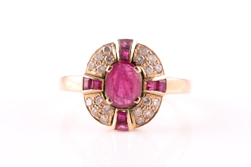 Lot 15 - A ruby and diamond cluster ring, the central...