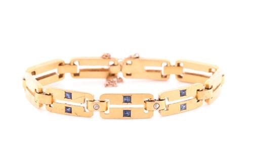 Lot 66 - A yellow metal, diamond and sapphire bracelet,...