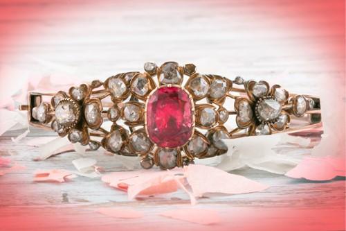 Lot 72 - An antique yellow metal and diamond bangle,...