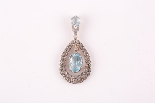 Lot 14 - A diamond and aquamarine pendant, set with a...