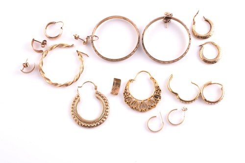 Lot 64 - A pair of 9ct yellow gold hoop earrings,...