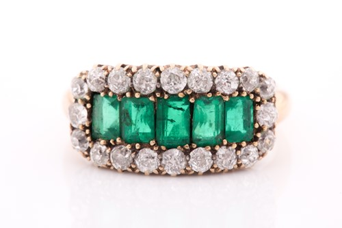 Lot 51 - An emerald and diamond three row ring, set...