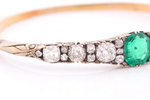 Lot 232 - A Victorian yellow gold, diamond, and emerald...