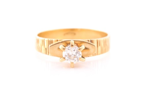 Lot 48 - An 18ct yellow gold and diamond ring, set with...