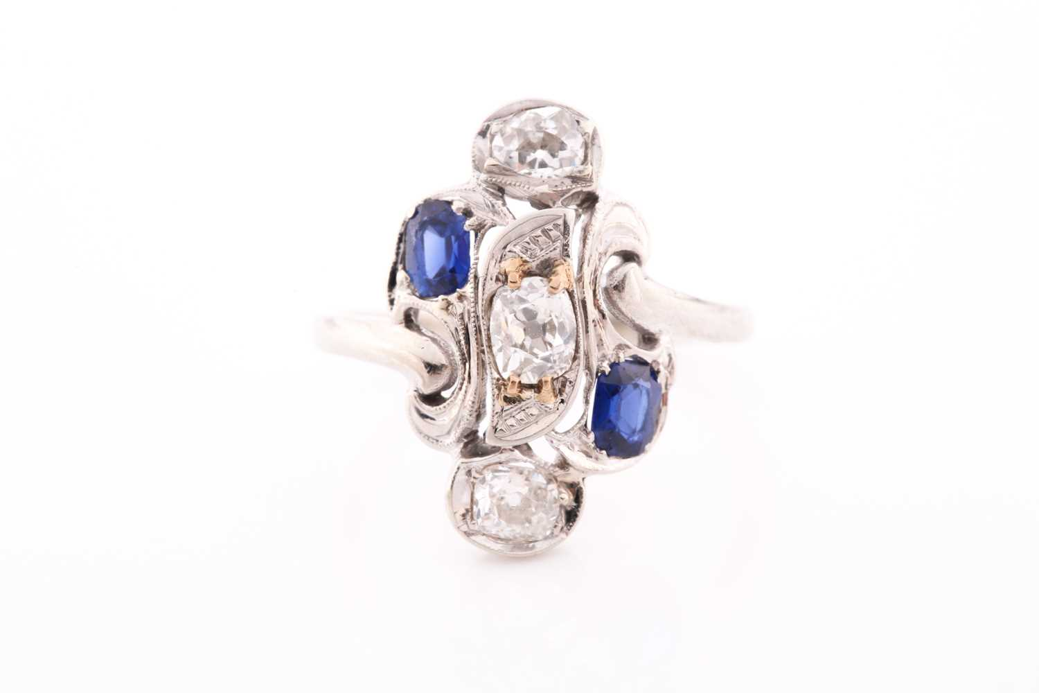 Lot 225 - A diamond and sapphire ring, in the Art...