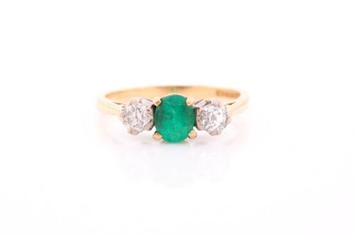 Lot 87 - A three stone half hoop emerald and diamond...