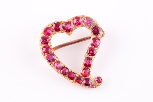 Lot 50 - A yellow metal and red spinel heart-shaped...