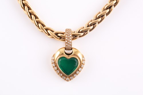 Lot 60 - An 18ct yellow gold, diamond, and green stone...