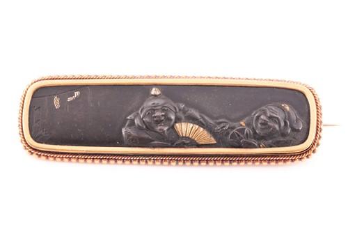 Lot 54 - A Japanese Shakudo brooch, the central panel...