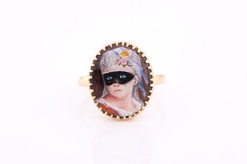 Lot 12 - A yellow metal and enamel ring, in the 19th...