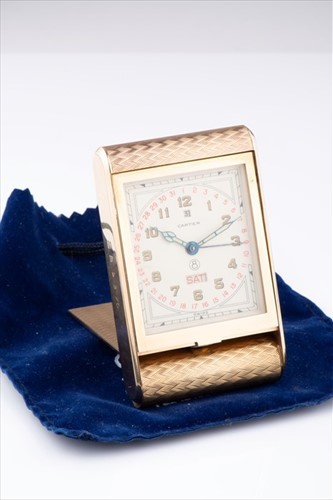 Lot 274-A fine Cartier 9ct yellow gold travel 8 day...