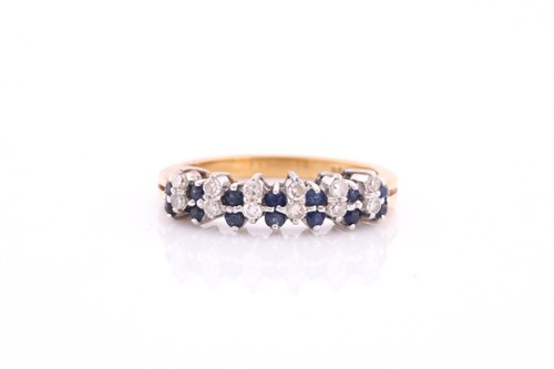 Lot 2 - A sapphire and diamond half hoop ring; the...